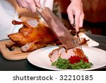 Chef cutting duck in chineese restaurant - stock photo