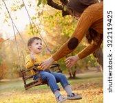happy baby boy having fun on a... | Shutterstock . vector #322119425
