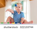 child boy playing with wooden... | Shutterstock . vector #322133744