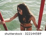 woman during a sunny day at the ... | Shutterstock . vector #322144589
