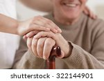 close up of helpful carer hand... | Shutterstock . vector #322144901