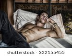 shirtless sexy male model lying ... | Shutterstock . vector #322155455