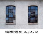 industrial window in concrete wall - stock photo