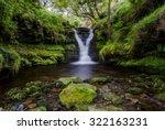 a waterfall hidden in a small...