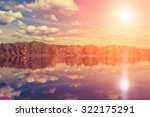 Stock photo autumn forest clouds reflected in a lake 322175291