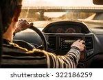 man hand driving a car at... | Shutterstock . vector #322186259