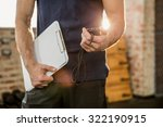 midsection of trainer holding... | Shutterstock . vector #322190915