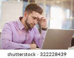 worried businessman looking at... | Shutterstock . vector #322228439