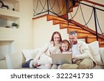 happy family sitting at home... | Shutterstock . vector #322241735