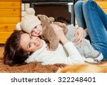 mother and baby playing and... | Shutterstock . vector #322248401