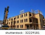 Condo community under construction with crane - stock photo