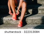 woman lacing running and sport... | Shutterstock . vector #322313084