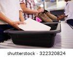man puts digital tablet into... | Shutterstock . vector #322320824
