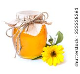 honey jar and yellow flower on... | Shutterstock . vector #322328261