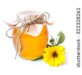 honey jar and yellow flower on... | Shutterstock . vector #322328261