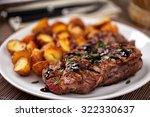 grilled beefsteak with potateos | Shutterstock . vector #322330637