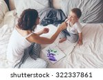 young mother with her 2 years... | Shutterstock . vector #322337861