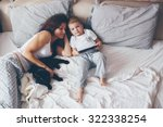 young mother with her 2 years... | Shutterstock . vector #322338254