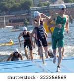 Small photo of STOCKHOLM - AUG 22, 2015: Ryan Bailie, Eric Lagerstrom and other of male swimmers climbing up from the water in the Men's ITU World Triathlon series event August 22, 2015 in Stockholm, Sweden
