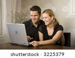 family playing with laptop... | Shutterstock . vector #3225379