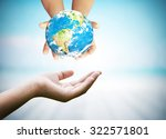 hands holding earth with on... | Shutterstock . vector #322571801
