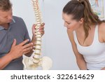 doctor showing anatomical spine ... | Shutterstock . vector #322614629