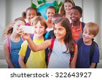 cute pupils using mobile phone... | Shutterstock . vector #322643927