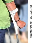 a person is holding some crutch | Shutterstock . vector #32268823