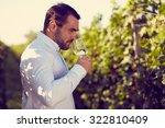winemaker tasting white wine in ... | Shutterstock . vector #322810409