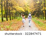 young family for a walk in a...   Shutterstock . vector #322847471