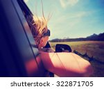 a woman with her head out the... | Shutterstock . vector #322871705
