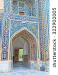 Small photo of The exit portal of Tilya Kori Madrasah decorated with blue geometric patterns, Samarkand, Uzbekistan.