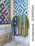 Small photo of Tourists can choose the traditional Uzbek clothes and accessories in numerous stalls in the courtyard of Tilya Kori Madrasah, Samarkand, Uzbekistan.