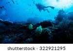 silhouette of diver underwater | Shutterstock . vector #322921295
