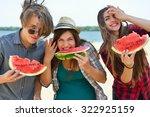 happy friends eating watermelon ... | Shutterstock . vector #322925159