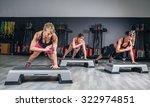 women group training hard over... | Shutterstock . vector #322974851