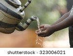 African Baby Washing Hands Wit...