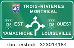 Guide and information road sign in Quebec, Canada - Roundabout with directions. Ouest means west, est means east.
