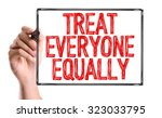 Small photo of Hand with marker writing: Treat Everyone Equally