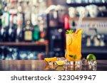 fresh cocktail with orange ... | Shutterstock . vector #323049947