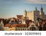 White castle with towers and green roofs and red roofs of residential and office houses in Szczecin, Poland