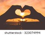 Silhouette Hand In Heart Shape...