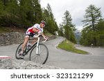 Cyclist Dby Downhill With Road...
