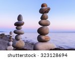 pyramidal group of stones on... | Shutterstock . vector #323128694