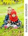 brother and sister on the fall... | Shutterstock . vector #323140325