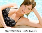 woman at the edge of a swimming ...   Shutterstock . vector #32316331
