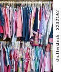 a young girls closet is stuffed ... | Shutterstock . vector #3232162