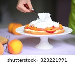 Woman Hand Put Whipped Cream O...