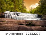 Motion Blur Waterfalls Nature Landscape in Blue Ridge Mountains Sunset with green trees, rusty rocks and flowing water - stock photo