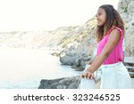 side portrait of a young... | Shutterstock . vector #323246525